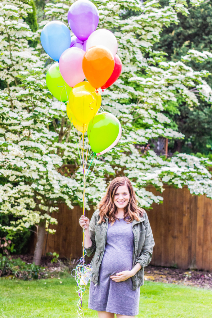 Rainbow balloons and baby bump