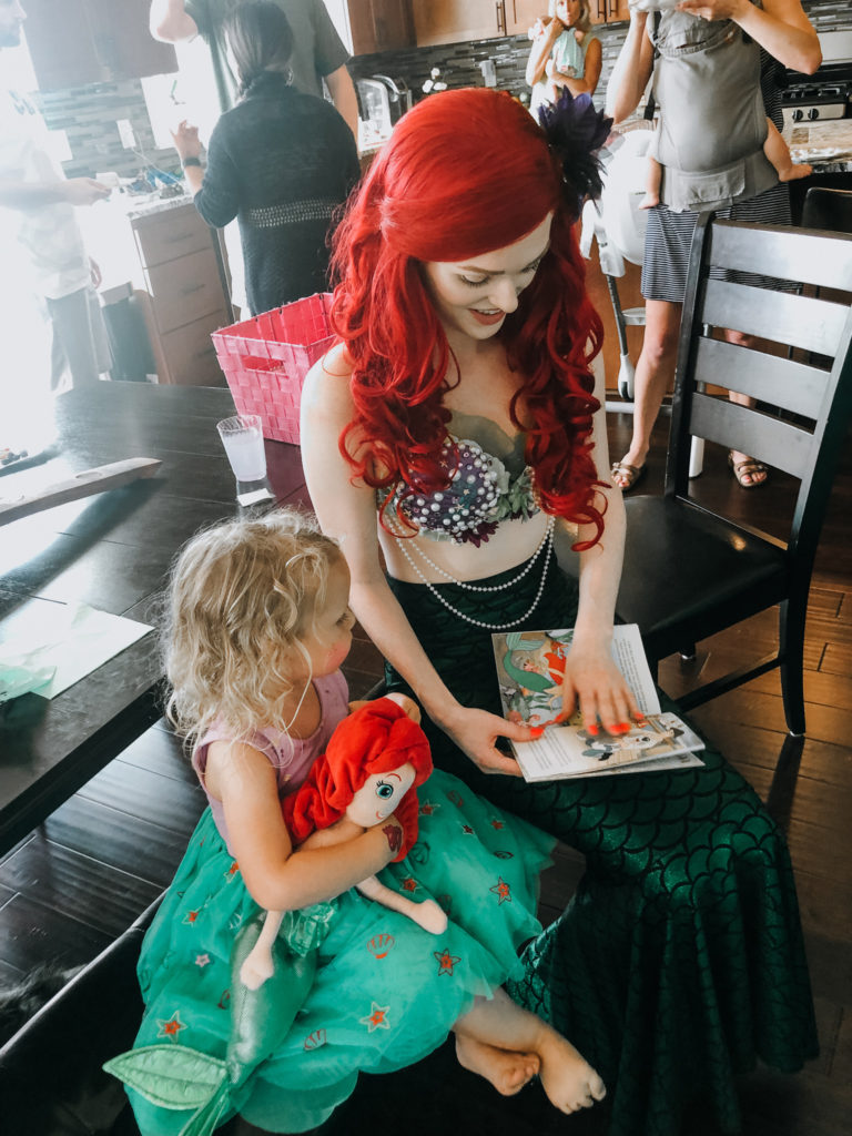 reading a book with ariel