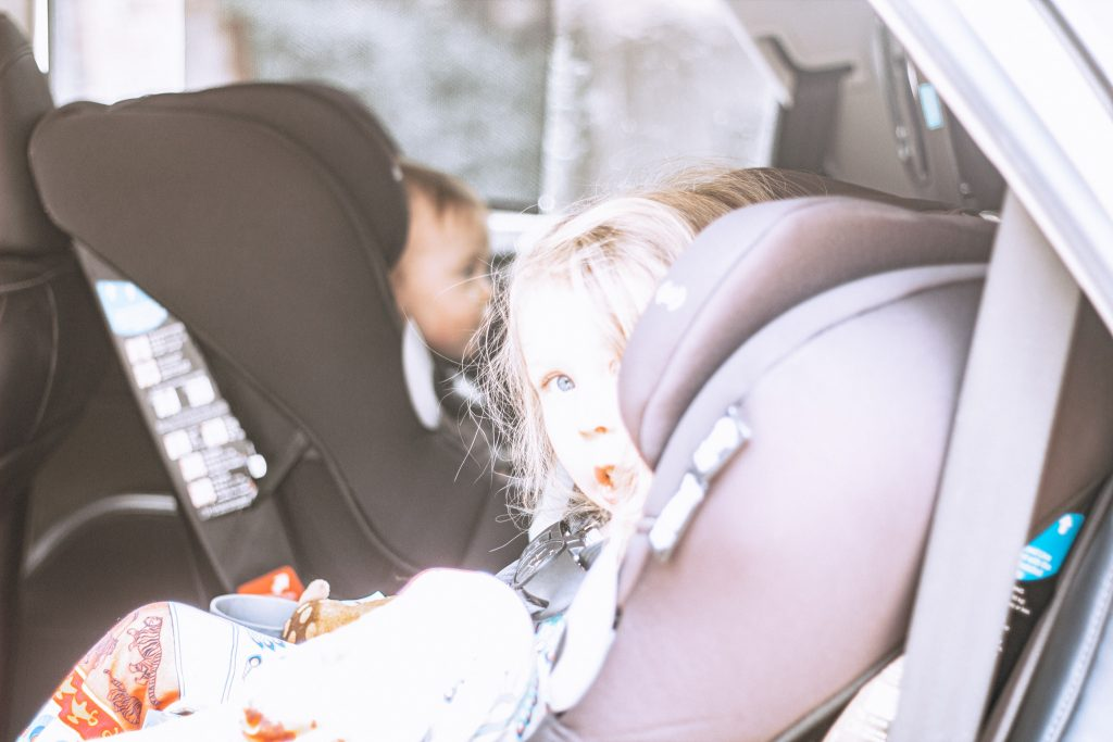 Little girl in car seat